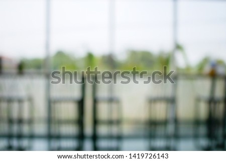 Blur or Defocus image of Coffee Shop or Cafeteria for use as Background #1419726143