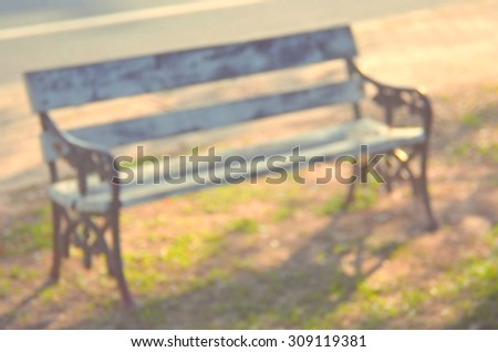 Blur outdoor chair in nature park abstract background.Retro color style.