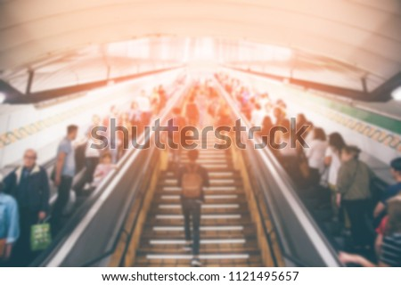Stock Photo blur passenger people in the subway station walking using escalator and stair in pedestrian subway railway station in rush hour. metro underground travel concept. Europe. blurred motion. filter retro