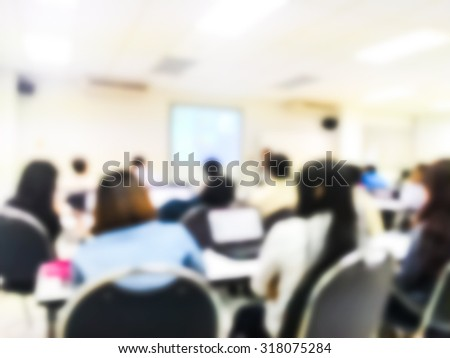 Blur people study or lecture or meeting or do workshop in classroom with notebook