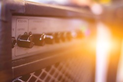 blur photo,A close-up of the power amplifier inside the rehearsal room makes it possible to see the amplifier's power amplifier in a beautiful and classic shape on the background of the sunrise.