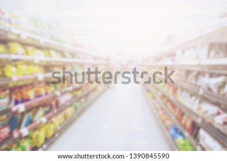 blur photo background of snacks and consumer product colorful in supermarket shop shelf. Mini-mart convenience stores are a new alternative for the urban people concept