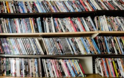 Blur photo, collection of movies, shelf full of DVD.