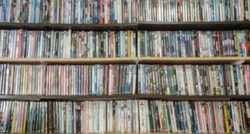 Blur photo, collection of movies, shelf full of DVD