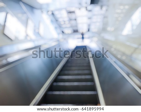 blur photo of escalator stair step to the next floor