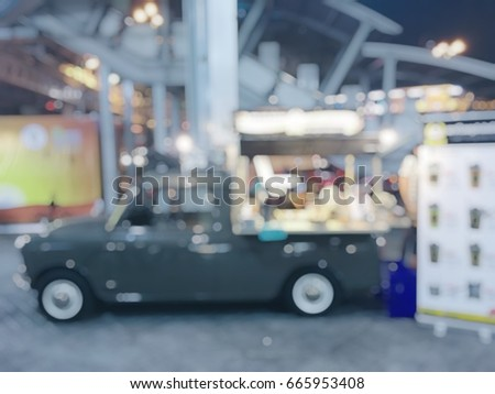 blur photo of truck stall selling street food at night time - business theme #665953408
