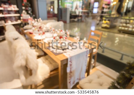 blur picture background of Christmas and new year display section display showroom in furniture mall