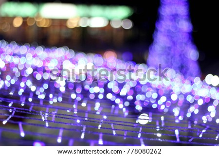 blur picture of christmas tree with lighting bokeh background for happy new year party