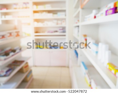 blur shelves filled with medication in the pharmacy