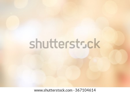 Blur shining brighten soft cream yellow wallpaper with circle lantern:abstract blurred background in light tone.blurry bulbs ball motion aura golden cream color backdrop.blurry sparkle glitter concept