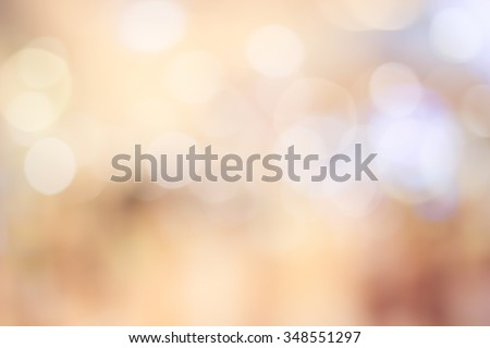 Blur shining brighten wallpaper with circle lantern:abstract blurred background in warm light colour toned.blurry bulbs ball motion of golden/yellow colored backdrop.blurry wedding ceremony concept.