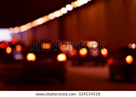 Blur shot of urban rush hour scene with multiple cars in a traffic congestion