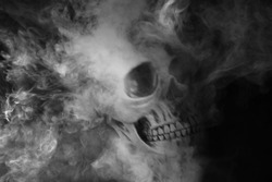 blur skull with smoke, black and white, ghost in the dark.