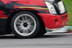 Blur speed car motion spin rotating tire wheel with white smoke on the road.