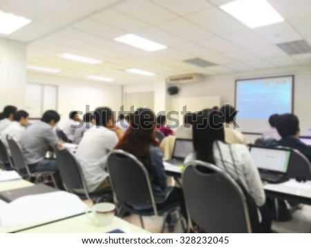 Blur student during study or lecture and quiz or exams from teacher or professor in classroom with notebook in master degree of industrial management programs or MBA class. study concept.