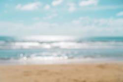 Blur summer bokeh beach with sun light and blue sky background.
