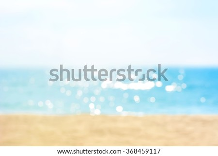 Blur summer white sand beach with sparkling sea water #368459117