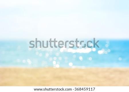 Blur summer white sand beach with sparkling sea water
