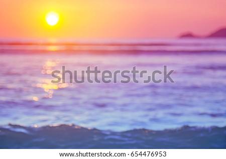 blur sunset beach with bokeh...