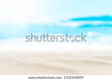 Stock Photo Blur tropical beach with bokeh sun light wave abstract background. Copy space of outdoor summer vacation and travel adventure concept. Vintage tone filter effect color style.