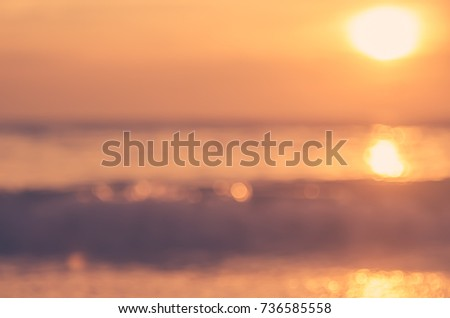 blur tropical sunset beach with ...