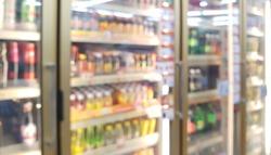 blur view of beverage displayed in refridgerators in convenience store. image of beverage cooler in market.