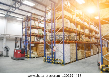 Blur Warehouse inventory product stock for logistic background, Long shelves with a variety of boxes (Lights background) #1303994416