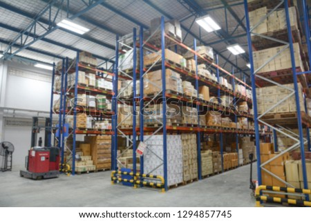 Blur Warehouse inventory product stock for logistic background, Long shelves with a variety of boxes #1294857745