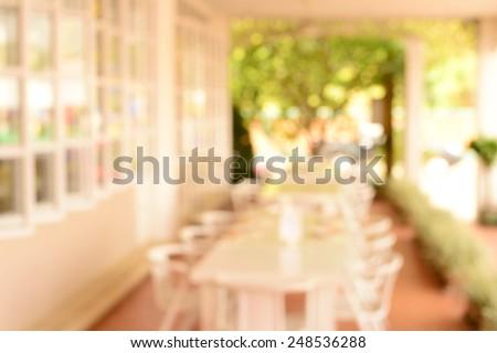 blur white decoration dinner restaurant interior and garden background