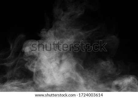 Blur white water vapour on isolated black background. Abstract of steam with copy space. Steam flow. Smoke on white background.