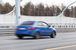 Blured car riding on high-speed road