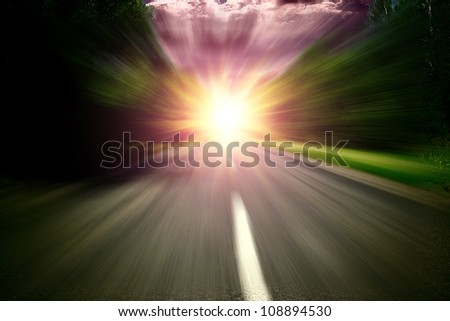 Blured  road over blue sky with sunset