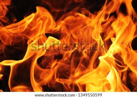 Blurrd Blaze fire flame texture background. #1349550599