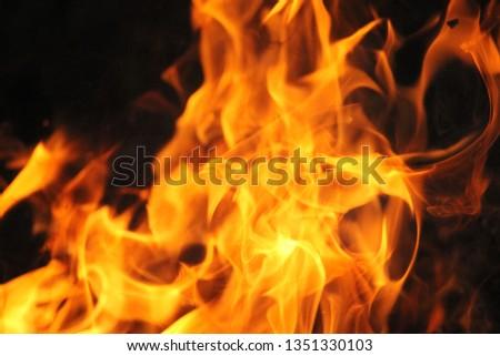 Blurrd Blaze fire flame texture background. #1351330103