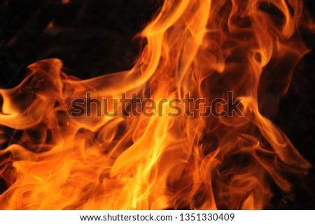Blurrd Blaze fire flame texture background. #1351330409
