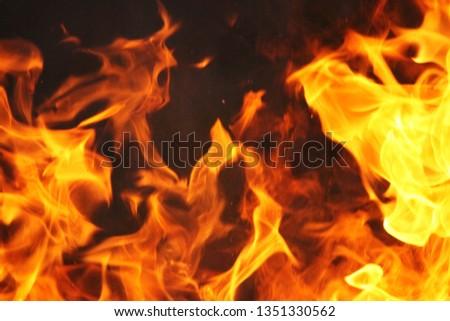 Blurrd Blaze fire flame texture background. #1351330562