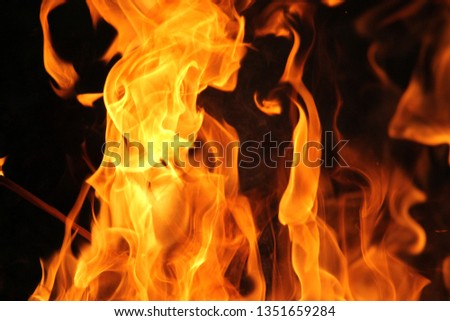 Blurrd Blaze fire flame texture background. #1351659284