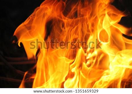 Blurrd Blaze fire flame texture background. #1351659329