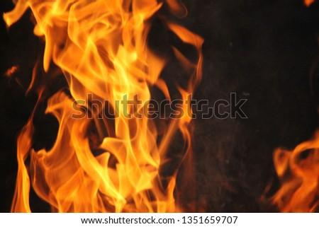 Blurrd Blaze fire flame texture background. #1351659707