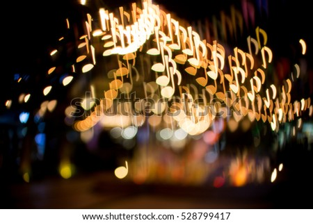 blurred abstract background christmas light with music note bokeh ...