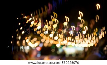 blurred abstract background christmas light with music note bokeh #530226076