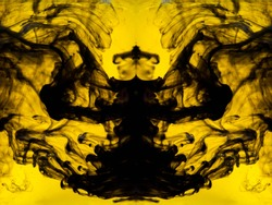 Blurred abstract background. Colorful inks in the water. Splash paint mixing. Watercolor effects. Ink pattern in Rorschach test style.