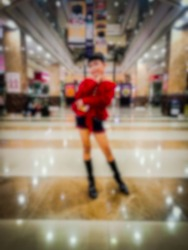 Blurred abstract background of a beautiful model girl posing with casual clothes at a mall