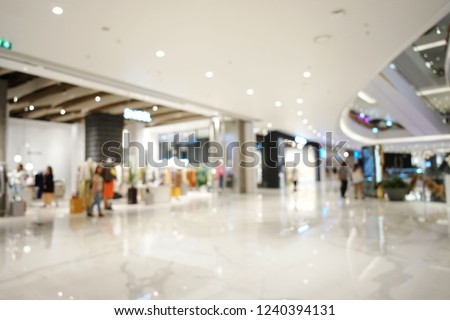 Blurred abstract background of a shopping mall interior with a large crowd of shoppers enjoying and relaxing in an ambience atmosphere