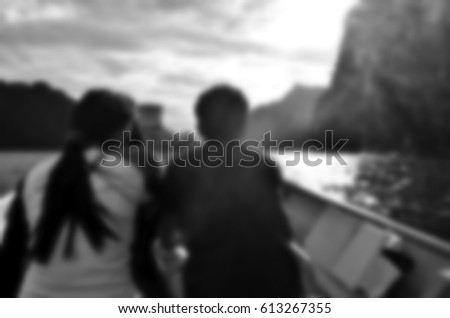 Blurred abstract background of couple travel on boat #613267355