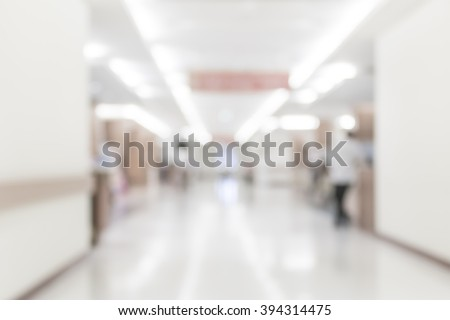 Blurred abstract background of hospital interior waiting hall/ corridor with patient in front of nurse station and OPD - out patient clinic department: Blurry view clinical indoor interior space