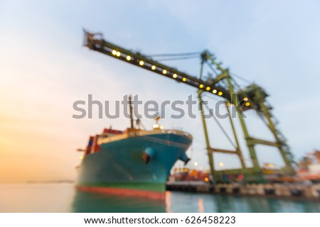 Blurred abstract background of Industrial port with container ship at dusk