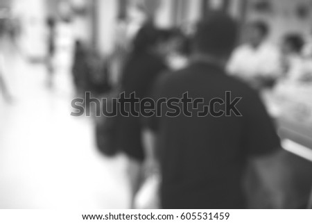 Blurred abstract background of people in shopping mall #605531459