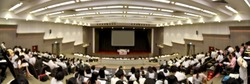 Blurred abstract background panorama of new students, audience and keynote speaker for freshman orientation day in international conference hall during graduation ceremony. event university or campus.