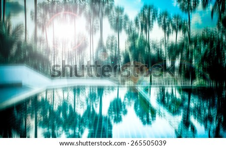 blurred abstract background photo of sugar palm and reflection on water with surreal motion blur effect